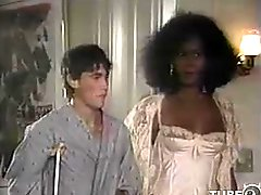 Interracial vintage threesome with a black tranny