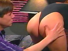 Curly-haired whore sucks a dick and gets her hairy snatch fucked from behind