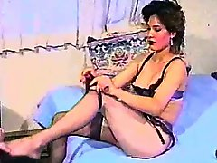 Retro milf with beautiful tits gets her pussy toyed in homemade clip