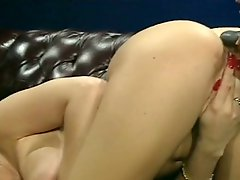 Sexy brunette lesbo ass fucks her lusty blond cutie from behind by big dildo