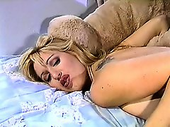 Vintage tape of a big booty blonde getting fucked with a strapon