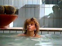 Salacious retro blonde gives blowjob next to the pool