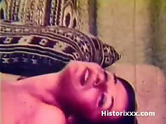 Busty beauty sucks huge dick and gets facial in vintage film