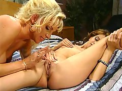 Alex Dane and Sahara Sands play with a strapon in retro lesbian video