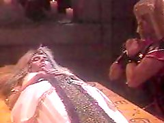 Old school video of a gorgeous blonde playing with her slave