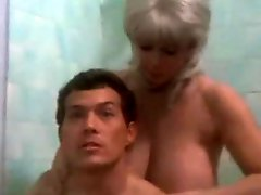 Busty cougar seduces younger man in the bathtub