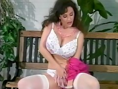 Retro brunette chick with huge fake tits shows off