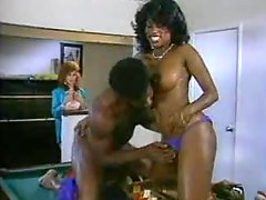 Slutty redhead chick joins a black couple banging in the living room