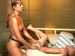 Mistress    with strap-on bouncing slave