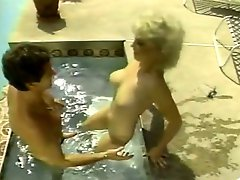 Busty chubby MILF takes sunbath over the pool and gets fucked