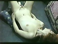 Dark haired titless bitch pleases her hot kitty with dildo