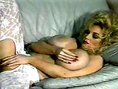 Vintage blonde milf shows off her enormous tits and hairy pussy