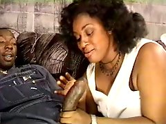 Horny black BBW chick in leather boots blowjob