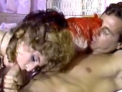Curly-haired chick gives a deep blowjob