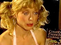 Nina Hartley sucks and rides Peter Norths cock in the kitchen