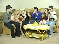 Naughty matures in a hot swingers sex party in this vintage scene