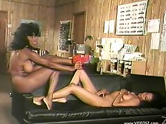 A retro video with two Black chicks having lesbian sex