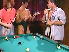 Sharon Mitchell, Viper and T.T. Boy do a threesome on a billiard table