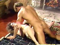 A naked girl is getting fucked on the floor in front of a fireplace...