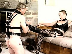 Vintage video of a mistress commanding her pets to lick her toes