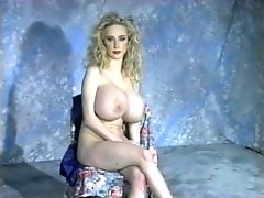 Solo blonde has gigantic fake tits to show off