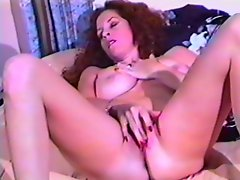 Busty babe fingers her wet pussy in vintage clip