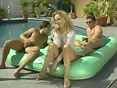 Vintage pornstar, Rebecca Bordoux, gets fucked by two cocks out by the pool