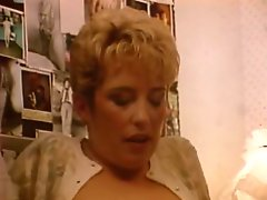 Busty blond mommy in sex suit is gonna suck that big staff cock